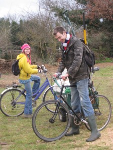 Tom and Kirsty, with unusual methods of carrying a spade on a bike