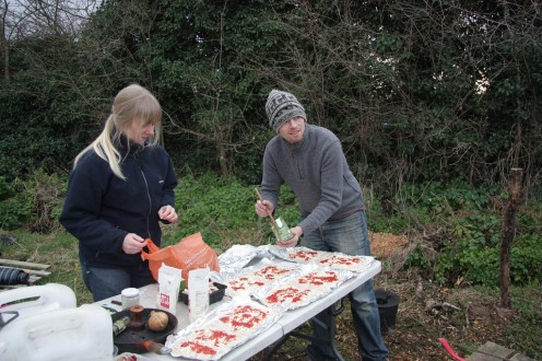 Dave and Sue adding the pizza toppings