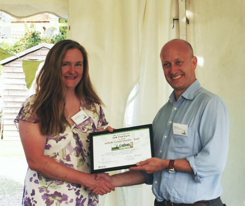 Joanne receiving the award presented by Oli of Groundwork