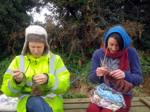 Gemma relaxing with her knitting at lunchtime with fellow crafting member Kaz.